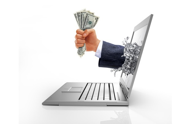 hands-crashing-through-laptop-computer-screen-to-grab-us-dollar-money-notes-o